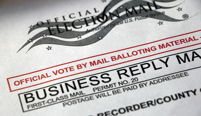 A close-up of a ballot envelope reads: Official vote-by-mail balloting material.