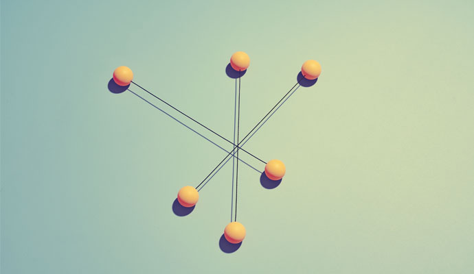 Six orange spheres are connected by thin rods radiating from a common center.