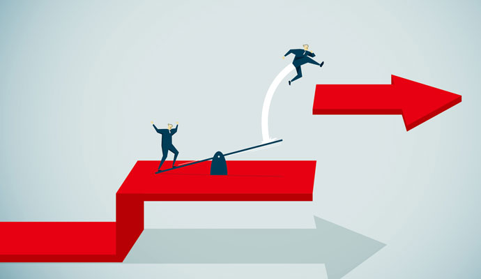 An illustration shows a businessperson catapulting another businessperson over a gap and onto a higher level.