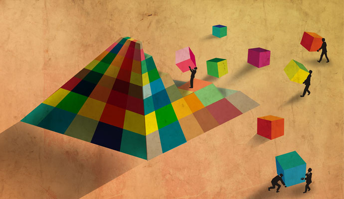 A stylized cartoon shows businesspeople assembling a pyramid with multicolored blocks.