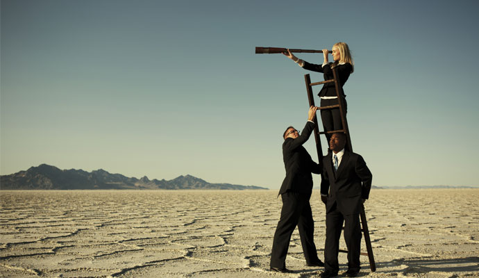 A businesswoman uses a ladder and a telescope to gain a better view.