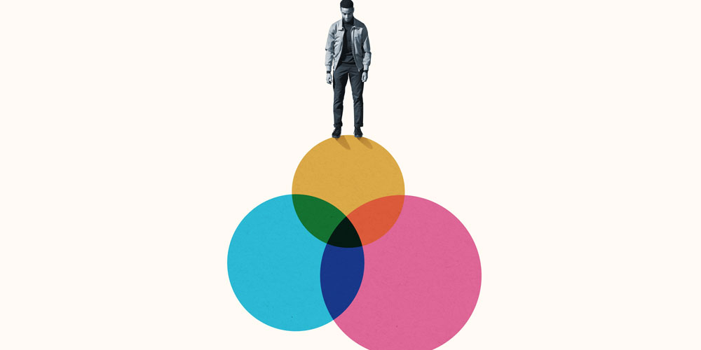 Man stands atop a Venn diagram of colorful circles